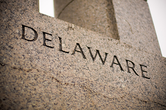 Granite cornerstone inscribed with DELAWARE represents our expertise in Delaware Holding Companies tax compliance